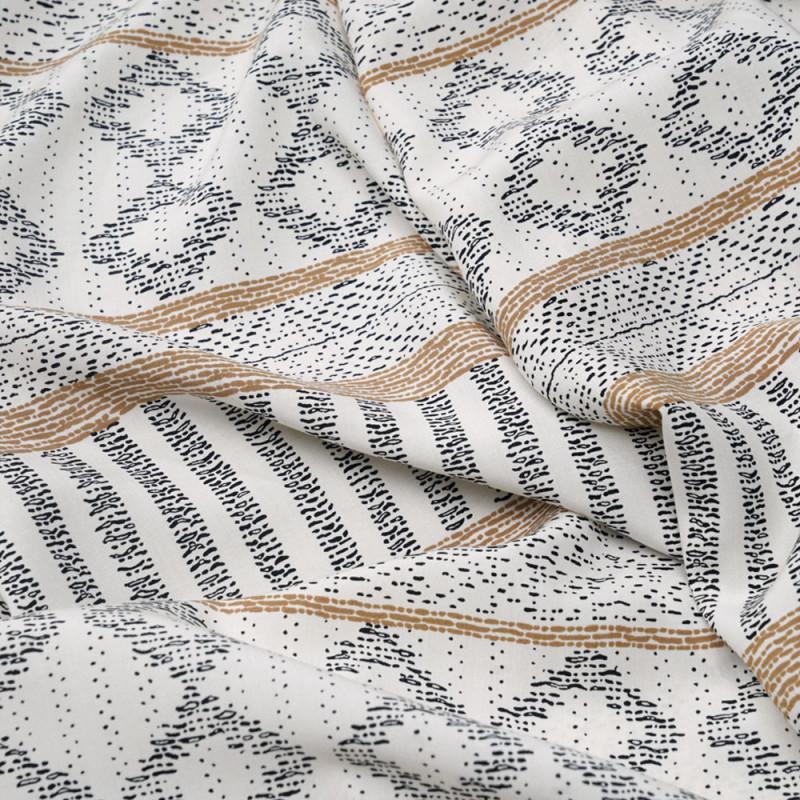 Tissu viscose blanc cassé à motif ethnique beige et noir - pretty mercerie - mercerie en ligne