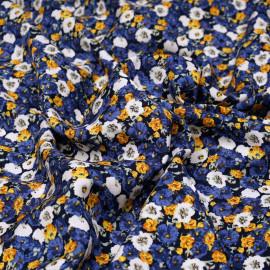 Tissu viscose bleu à fleurs blanches, jaunes et bleues x 10cm