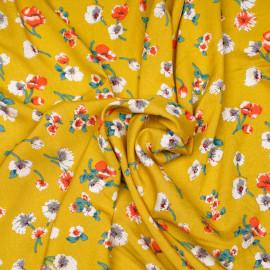 Tissu viscose ocre à fleurs blanches, bleues et oranges - pretty mercerie -mercerie en ligne