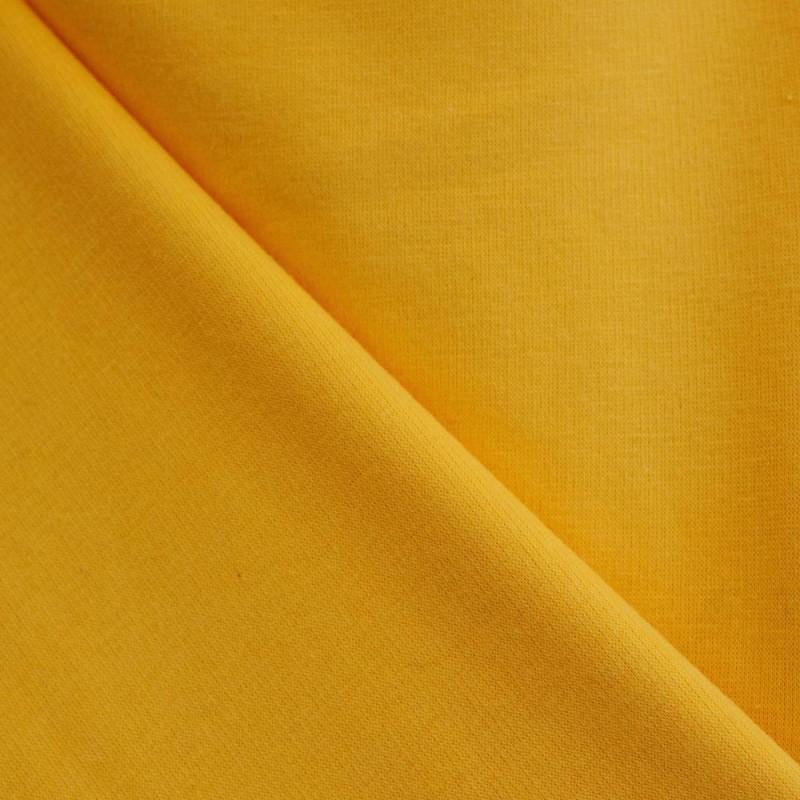 Tissu sweat ambre jaune