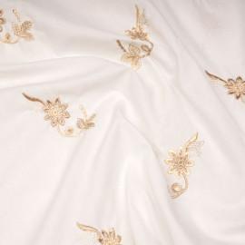 Tissu coton blanc cassé motif fleurs brodées sables x 10cm