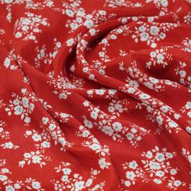 Tissu effet froissé rouge aurora à motif fleuri blanc x 10cm