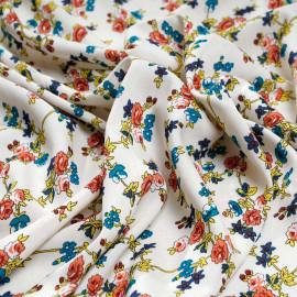 Tissu viscose écru à motif fleuri bleu jaune et corail x 10 cm
