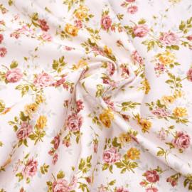 Tissu coton rose pastel à motif fleuri rose et orange x 10cm