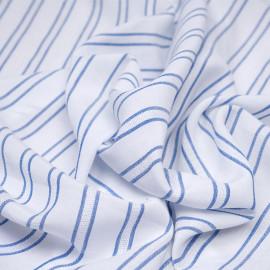 Tissu viscose blanche rayé et brodé bleu denim x 10 CM