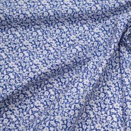 Tissu coton bleu à motif fleuri blanc x 10cm