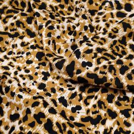 Tissu viscose écru imprimé léopard noir et fauve  x 10 CM