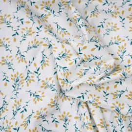 Tissu coton blanc cassé à motif branche vert et lemon curry x 10cm