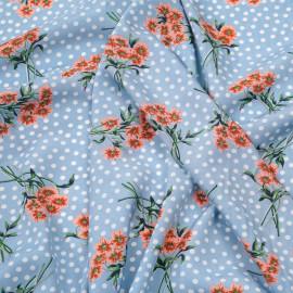 Tissu viscose bleu ciel à pois blanc et jolis bouquets fleuris abricots x 10 CM
