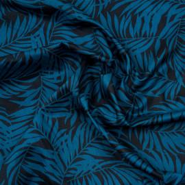 Tissu coton noir à motif feuille de palmier bleu corsair x 10cm