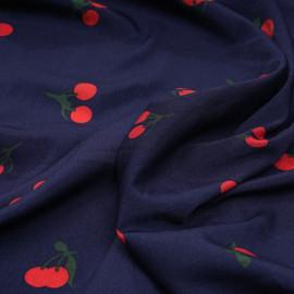 Tissu bleu marine à motif cherry rouge et vert x 10 cm