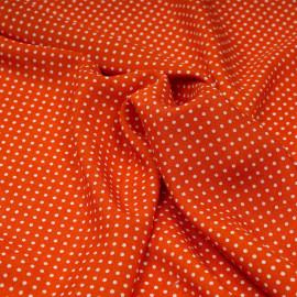 Tissu viscose spicy orange à petits pois blanc X 10 CM