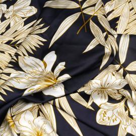 Tissu satiné bleu profond à motif fleurs tropicales blanc cassé et moutarde x 10 cm