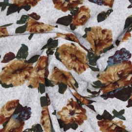 Tissu jersey gris chiné motif grosses fleurs  x 10cm