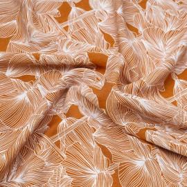 Tissu coton caramel à motif fleuri blanc  X 10 CM