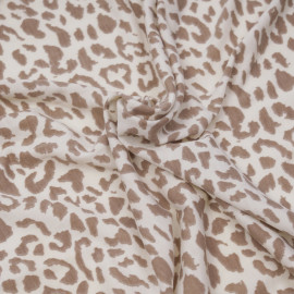 Tissu jersey chocolat blanc  à motifs léopard beige x 10cm