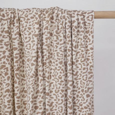 Tissu jersey chocolat blanc à motifs léopard beige - pretty mercerie - mercerie en ligne