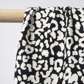 Tissu viscose crêpe noir à motif léopard blanc cassé | Pretty Mercerie | mercerie en ligne