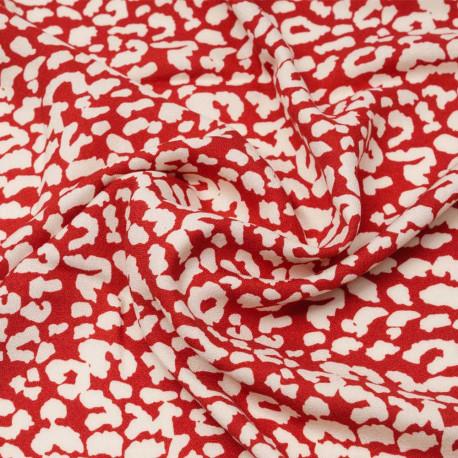 Tissu viscose crêpe rouge à motif léopard blanc cassé | Pretty Mercerie | mercerie en ligne