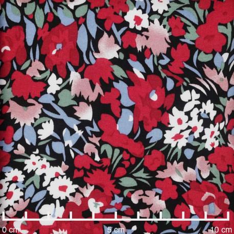 Tissu viscose noir à motif floral abstrait rouge et bleu | pretty mercerie | mercerie en ligne
