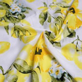 Tissu coton blanc imprimé motif citron et orchidée x 10cm