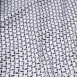 Tissu blanc à motif bleu et beige x 10cm