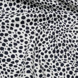 Tissu coton sergé blanc imprimé motif léopard noir x 10cm