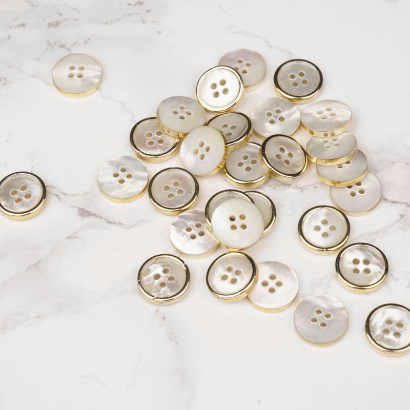 Bouton nacre blanc cerclé métal or 11 mm - mercerie en ligne - pretty mercerie