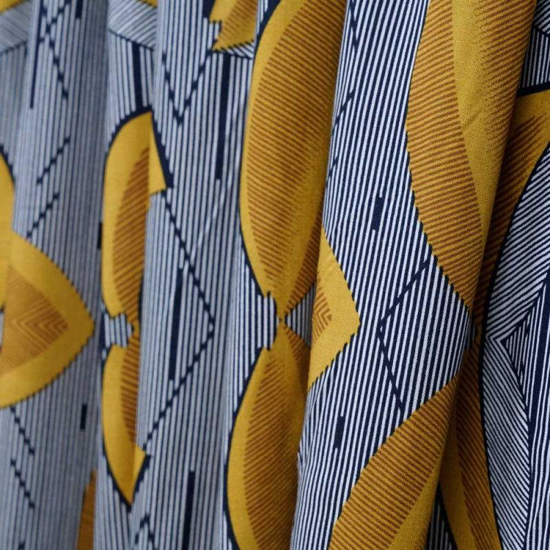Tissu viscose à motif africa rayé bleu et feuilles ocre - pretty mercerie - mercerie en ligne