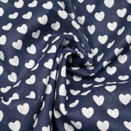 Tissu toile de coton bleu motif coeur blanc cassé x 10cm