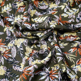 Tissu crêpe vert avocat motif feuillage lilas jaune sunshine noir et rust x 10cm